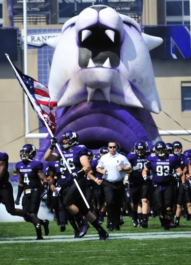 The Northwestern Wildcats take the field in a game against the California Golden Bears on August 30, 2014 at Ryan Field in Evanston, Illinois. (David Banks/Getty Images)
