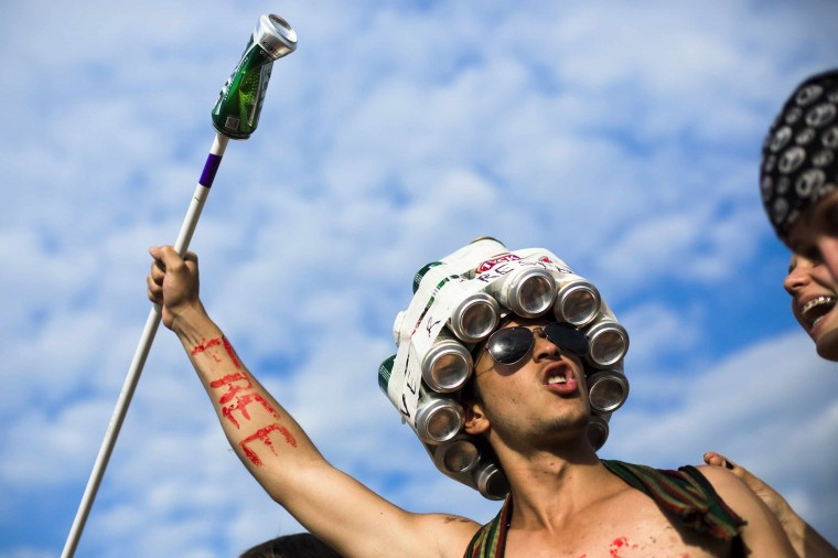 A reveller wears a hat made of beer cans at the Woodstock Festival in Kostrzyn-upon-Odra, close to the Polish-German border. Some 500,000 people attended the festival that is the brainchild of Polish journalist and social campaigner Jerzy Owsiak. He initiated the event to say thank you to those who donated money to his GOCC charity organisation that delivers medical care for children. (Thomas Peter/Reuters)