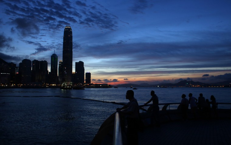 "People look towards the city skyline during sunset in Hong Kong. Growth in Hong Kong's economy remained ""moderate"" year-on-year in the first quarter of 2014, dragged by sluggish exports affected by a lack of progress in advanced economies, officials said in May. (Dale de la Ray/AFP-Getty Images)"