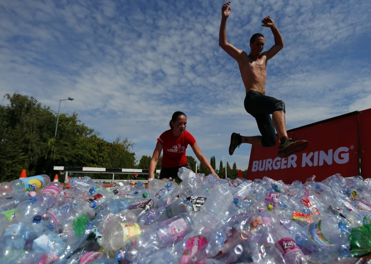 A competitor jumps to run through plastic bottles during the Brutal Run extreme obstacle course race in Budapest. (Laszlo Balogh/Reuters)