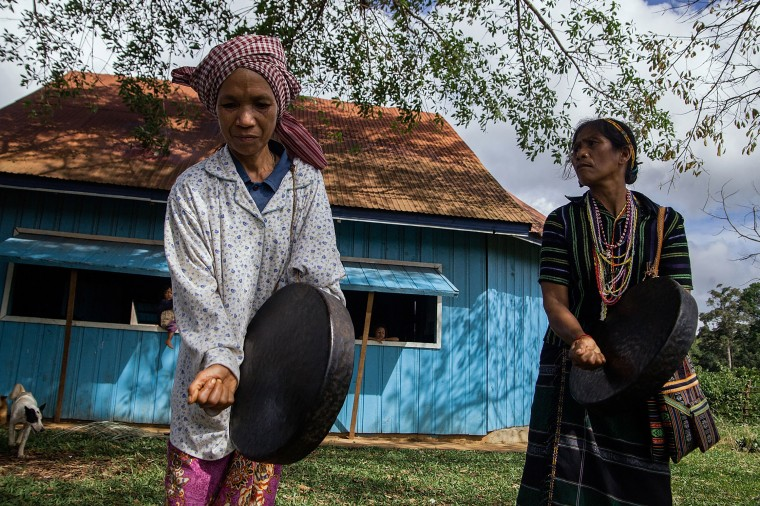 Women from the Bunong indigenous community stand by their home in Mondulkiri, Cambodia. Cambodia's indigenous groups are at risk as their ancestral lands are being threatened by businesses interested in commercially developing the areas. On August 9, the UN focuses on the rights of the World's Indigenous People on International Indigenous People's Day. (Hannah Reyes/Getty Images)