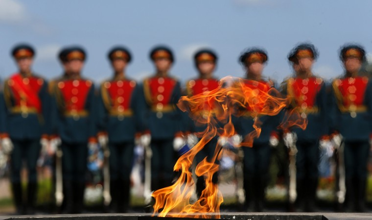 Russian servicemen are seen through the Eternal Flame during a ceremony to mark the Paratroopers Day in central St. Petersburg. The holiday for the Russian airborne troops has been annually celebrated since the Soviet era till today. (Alexander Demianchuk/Reuters)