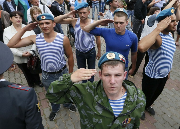 Former paratroopers give a salute as they take part in the celebrations for the Paratroopers Day in the central park in Russia's Siberian city of Krasnoyarsk. The holiday for the Russian airborne troops has been annually celebrated since the Soviet era till today. (Ilya Naymushin/Reuters)