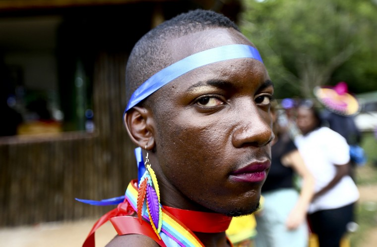 A man is pictured as he prepares for a parade to celebrate the annulment of an anti-homosexuality law by Uganda's constitutional court in Entebbe. Last week, the east African country's constitutional court nullified the anti-homosexuality law, signed by President Yoweri Museveni in February, on a technicality, saying it had been passed by parliament without quorum. Uganda's parliament will try to re-introduce the law, a lawmaker leading the effort said on Wednesday, a move that could once again damage relations with the West. (Edward Echwalu/Reuters)