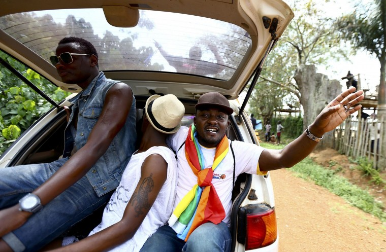 People sit in the boot of a car while celebrating the annulment of an anti-homosexuality law by Uganda's constitutional court in Entebbe. Last week, the east African country's constitutional court nullified the anti-homosexuality law, signed by President Yoweri Museveni in February, on a technicality, saying it had been passed by parliament without quorum. Uganda's parliament will try to re-introduce the law, a lawmaker leading the effort said on Wednesday, a move that could once again damage relations with the West. (Edward Echwalu/Reuters)