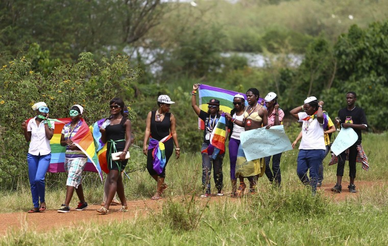 People walk in a parade as they celebrate the annulment of an anti-homosexuality law by Uganda's constitutional court in Entebbe. Last week, the east African country's constitutional court nullified the anti-homosexuality law, signed by President Yoweri Museveni in February, on a technicality, saying it had been passed by parliament without quorum. Uganda's parliament will try to re-introduce the law, a lawmaker leading the effort said on Wednesday, a move that could once again damage relations with the West. (Edward Echwalu/Reuters)
