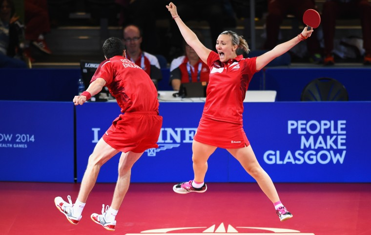 Kelly Sibley and Danny Reed of England celebrate winning the bronze medal following their Mixed Doubles Bronze Medal Match against Jian Zhan and Tianwei Feng of Singapore at Scotstoun Sports Campus during day ten of the Glasgow 2014 Commonwealth Games in Glasgow, Scotland. (Jeff J Mitchell/Getty Images)