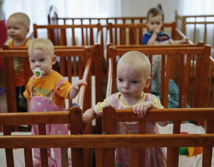 Children who were transferred from orphanages in Donetsk and Makeyevka stand in their cribs in an orphanage in Kramatorsk. More than 70 children from orphanages in Donetsk and Makeyevka in eastern Ukraine were sent to Kramatorsk due to fighting between the Ukrainian army and pro-Russian separatists. (Gleb Garanich/Reuters)
