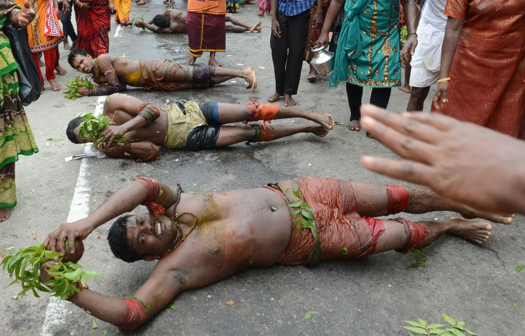 Sri Lankan Tamil Hindu devotees roll on the ground during the Vel Hinduism festival in Colombo. Ethnic Tamils, who are mainly followers of Hinduism, are the main minority community in the island which is emerging from nearly four decades of ethnic conflict which had claimed up to 100,000 lives (Lakruwan Wanniarachchi/AFP-Getty Images)