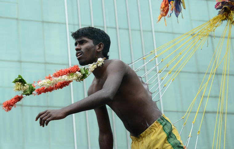 A Sri Lankan Tamil Hindu devotee, seen suspended with hooks pierced through his body, participates in the Vel Hinduism festival in Colombo. Ethnic Tamils, who are mainly followers of Hinduism, are the main minority community in the island which is emerging from nearly four decades of ethnic conflict which had claimed up to 100,000 lives (Lakruwan Wanniarachchi/AFP-Getty Images)