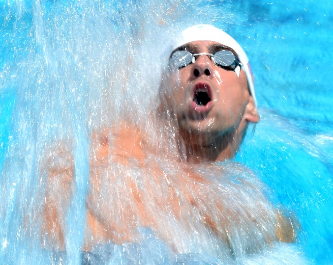Michael Phelps swims in the Men's 100 Meter Backstroke Prelims during the 2014 Phillips 66 National Championships at the Woollett Aquatic Center in Irvine, California. (Harry How/Getty Images)