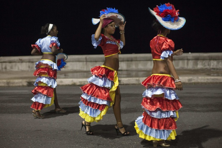 Revellers chat on a street before performing at a carnival parade in Havana. (Alexandre Meneghini/Reuters)