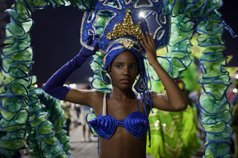 A reveller prepares to perform at a carnival parade in Havana. (Alexandre Meneghini/Reuters)
