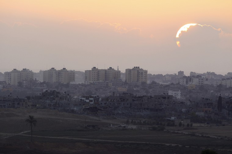 """Sun sets over northern Gaza Strip as seen from the Israeli border. Israeli Prime Minister Benjamin Netanyahu threatened on Saturday to exact an """"intolerable price"""" from the Gaza Strip's dominant Hamas Islamists should there be continued attacks from the Palestinian territory. Shelling exchanges continued, pushing the Gaza death toll given by Palestinian officials up to 1,669, but in some areas witnesses reported Israeli tanks pulling back toward the border. Israel said Palestinians launched 74 rockets across the border, most of which fell harmlessly wide while seven were shot down by its Iron Dome interceptor, including over Tel Aviv. (Amir Cohen/Reuters)"""