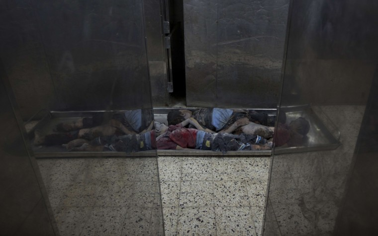The bodies of three children from the Al-Nirab family who were killed alongside their parents are seen at a morgue in Gaza City after an Israeli attack on the Palestinian enclave. A fresh wave of violence killed dozens in Gaza after the collapse of a UN and US backed ceasefire, officials said, as Hamas denied it kidnapped an Israeli soldier. (Mahmud Hams/AFP-Getty Images)