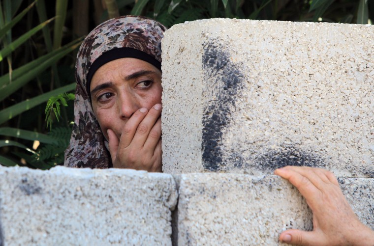A Palestinian woman reacts during the funeral of 19-year-old Udai Nafez, killed during clashes with Israeli forces in Saffa a village west of Ramallah, in the West Bank village of Rafat. Israeli forces shot dead two Palestinians during separate clashes in the northern and central West Bank on Friday, security and medical sources told AFP. (Abbas Momani/AFP-Getty Images)