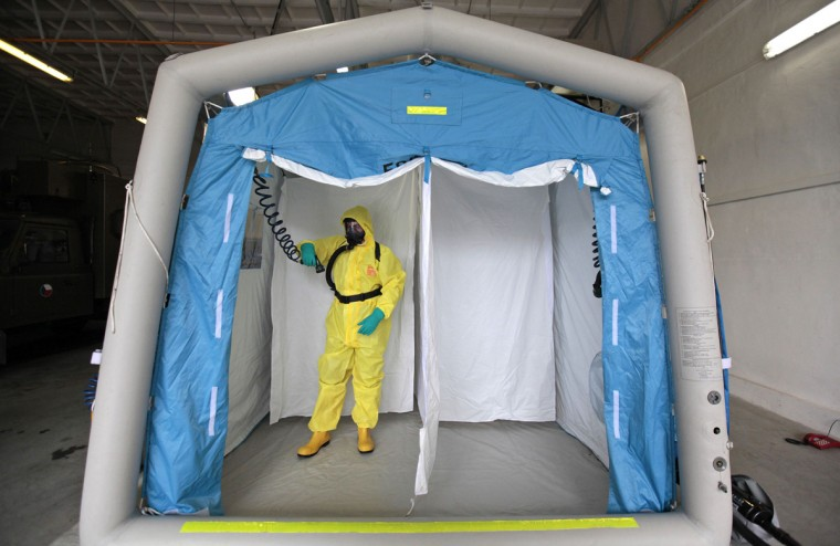 A Czech military personnel wearing protective gear takes part in a drill in the Biological Defence Centre, a specialised medical institution ensuring complete biological defence, in the village of Techonin August 11, 2014. The Biological Defence Department is involved in the NATO biological defence system and is equipped for treatment of possible Ebola virus patients. (David W Cerny/Reuters)