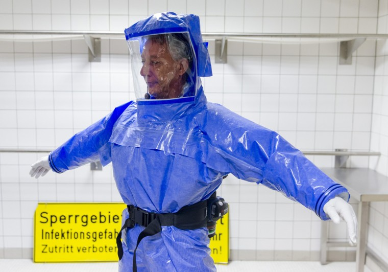 Ward physician Thomas Klotzkowski wears a protective suit at the quarantine station for patients with infectious diseases at the Charite hospital in Berlin August 11, 2014. (Thomas Peter/Reuters)