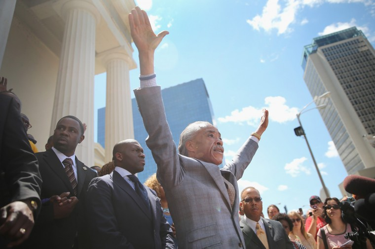 Civil rights leader Rev. Al Sharpton speaks about the killing of teenager Michael Brown at a press conference held on the steps of the old courthouse on August 12, 2014 in St. Louis, Missouri. When their hands are up you don't shoot, exclaimed Sharpton, who was referring to reports that Brown was shot while his hands were raised in the air. Brown was shot and killed by a police officer on Saturday in suburban Ferguson, Missouri. Sharpton and Browns family were calling for order following riots and skirmishes with police over the past two nights in Ferguson by demonstrators angry over the shooting. (Photo by Scott Olson/Getty Images)