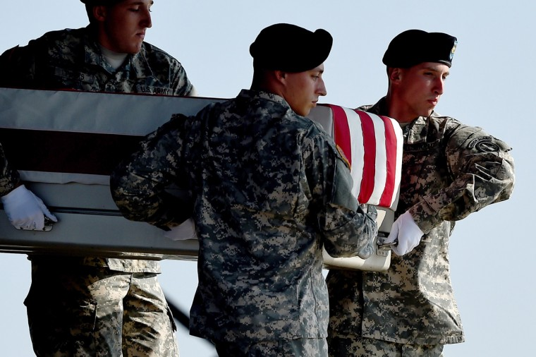 U.S. Army soldiers carry the flag-draped transfer case containing the remains of U.S. Army Maj. Gen. Harold J. Greene during a dignified transfer at Dover Air Force Base on August 7, 2014 in Dover, Delaware. According to reports, Greene, who was from Schenectady, New York, assigned to the Combined Security Transition Command, was killed after his unit was attacked in Afghanistan. (Photo by Patrick Smith/Getty Images)