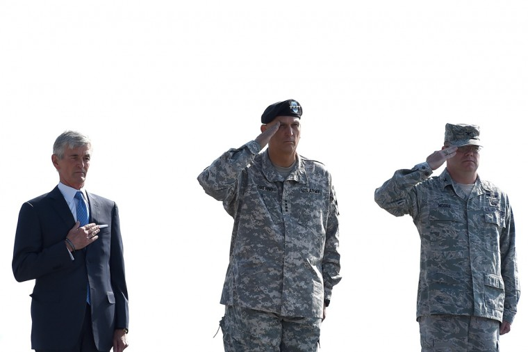 U.S. Army Secretary John McHugh (L) holds his hand over his heart as U.S. Army Chief of Staff Ray Odierno (C), and Dignified Transfer Host, U.S Air Force Col. Richard G. Moore salute, during the dignified transfer of the remains of U.S. Army Maj. Gen. Harold J. Greene at Dover Air Force Base on August 7, 2014 in Dover, Delaware. According to reports, Greene, who was from Schenectady, New York, assigned to the Combined Security Transition Command, was killed after his unit was attacked in Afghanistan. (Photo by Patrick Smith/Getty Images)