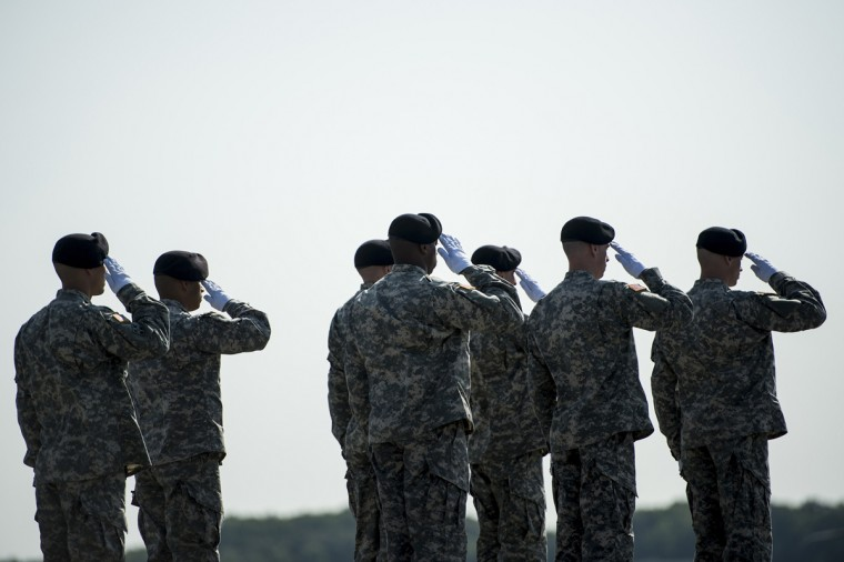 A US Army carry team salutes as the remains of US Army Maj. Gen. Harold J. Greene are driven away during a dignified transfer at Dover Air Force Base August 7, 2014 in Delaware. Major General Harold J. Greene was shot dead on August 5, 2014 at a training center in Kabul in an attack that left more than a dozen others wounded, including a senior German officer. (Brendan Smialowski/AFP/Getty Images)