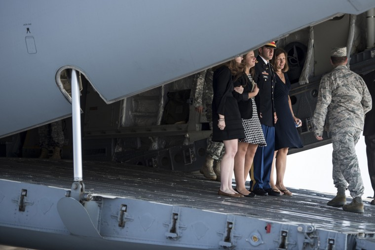 The wife of US Army Maj. Gen. Harold J. Greene, Susan Myers (2ndR), son US Army First Lieutenant Matthew Greene (C), daughter-in-law Kasandra Greene (L), daughter Amelia Greene (2nd-L) walk off a C-17 after speaking with the flight crew after a dignified transfer at Dover Air Force Base on August 7, 2014 in Delaware. General Greene was killed at Marshal Fahim National Defense University in the Qarga District of Kabul, Afghanistan by an Afghan soldier. (Brendan Smialowski/AFP/Getty Images)