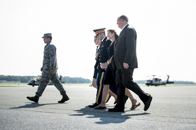 The wife of US Army Maj. Gen. Harold J. Greene, Susan Myers (2nd-R) walks with her son US Army First Lieutenant Matthew Greene (3rd-R), daughter-in-law Kasandra Greene (L), daughter Amelia Greene (2nd-L) and others to speak with a C-17's flight crew after a dignified transfer at Dover Air Force Base August 7, 2014 in Delaware. Major General Harold J. Greene was shot dead on August 5, 2014 at a training center in Kabul in an attack that left more than a dozen others wounded, including a senior German officer. (Brendan Smialowski/AFP/Getty Images)