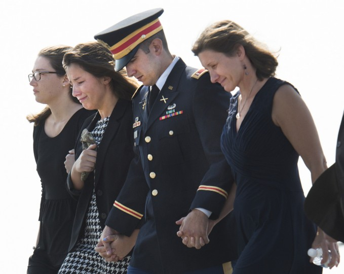 The family of Army Maj. Gen. Harold J. Greene, from left, daughter Amelia Greene, daughter-in-law Kasandra Greene, son Army 1st Lt. Matthew Greene and his wife, retired Col. Susan Myers, arrive at the dignified transfer at Dover Air Force Base. (Washington Post photo by Linda Davidson)