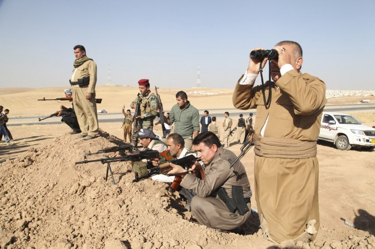 """Kurdish peshmerga troops participate in an intensive security deployment against Islamic State militants on the front line in Khazer on August 8, 2014. U.S. warplanes bombed Islamist fighters marching on Iraq's Kurdish capital on Friday after President Barack Obama said Washington must act to prevent """"genocide"""". (REUTERS/Azad Lashkari)"""