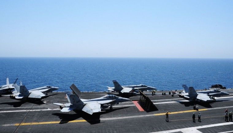 Sailors launch aircraft from the flight deck of the aircraft carrier USS George H.W. Bush (CVN 77) in the Gulf, in this August 7, 2014 handout image released on August 8. Two F/A-18 aircraft conducted an airstrike on Friday against Islamic State artillery used against Kurdish forces defending the city of Arbil, near U.S. personnel, a Pentagon spokesman said. Picture taken August 7, 2014. (REUTERS/Mass Communication Specialist 3rd Class Joshua Card/U.S. Navy/Handout via Reuters)