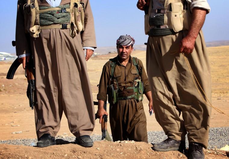 Iraqi Kurdish Peshmerga fighters take position on the front line in Khazer, near the Kurdish checkpoint of Aski kalak, 40 km West of Arbil, the capital of the autonomous Kurdish region of northern Iraq, on August 8, 2014. A spokesman for the Kurdish peshmerga force said US warplanes bombed Islamic State jihadist targets in two areas of northern Iraq. (SAFIN HAMED/AFP/Getty Images)
