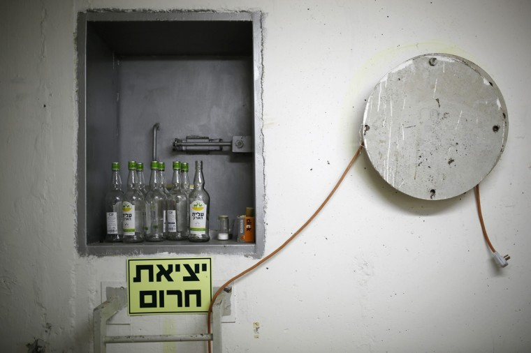 Bottles of an alcoholic drink are seen in a bomb shelter in the Israeli southern city of Ashkelon July 31, 2014. Israel declared a Gaza ceasefire over on Friday, saying Hamas militants breached the truce soon after it came in effect and apparently captured an Israeli officer while killing two other soldiers. The 72-hour break announced by U.S. Secretary of State John Kerry and U.N. Secretary-General Ban Ki-moon was the most ambitious attempt so far to end more than three weeks of fighting, and followed mounting international alarm over a rising Palestinian civilian death toll. Picture taken July 31, 2014. (Amir Cohen/Reutrs)
