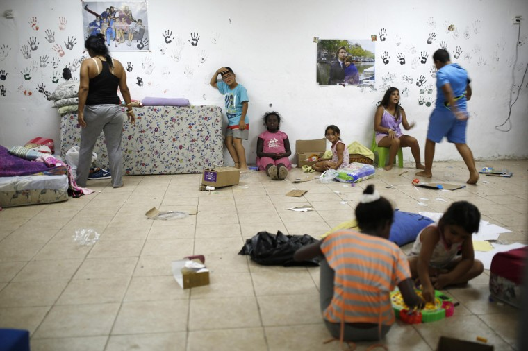 Israelis are seen in a bomb shelter in the Israeli southern city of Ashkelon July 31, 2014. Israel declared a Gaza ceasefire over on Friday, saying Hamas militants breached the truce soon after it came in effect and apparently captured an Israeli officer while killing two other soldiers. The 72-hour break announced by U.S. Secretary of State John Kerry and U.N. Secretary-General Ban Ki-moon was the most ambitious attempt so far to end more than three weeks of fighting, and followed mounting international alarm over a rising Palestinian civilian death toll. Picture taken July 31, 2014. (Amir Cohen/Reutrs)