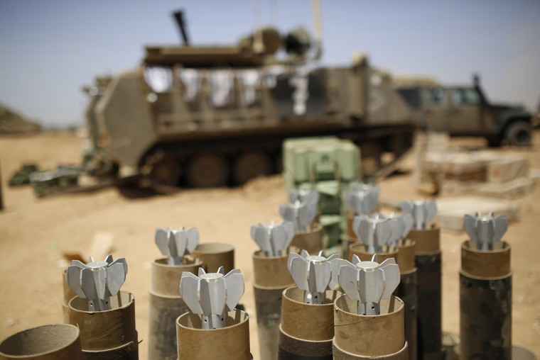 Mortar bombs are seen in containers at an Israeli military staging area near the border with Gaza July 30, 2014. The Israeli military said on Wednesday it would hold fire unilaterally in limited areas of the Gaza Strip for four hours from 3 p.m. (1200 GMT) for humanitarian purposes, an army statement said. Hamas described the truce as a media stunt because it only applied to some areas. (Amir Cohen/Reutrs)