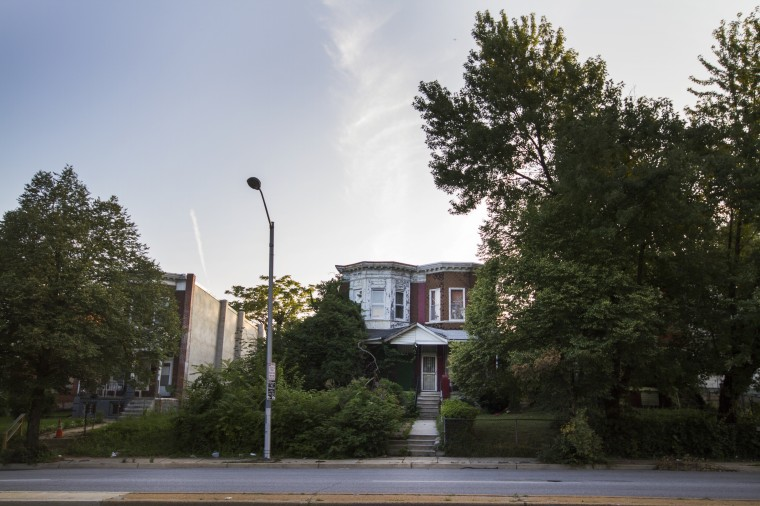 A rowhome along Park Heights Avenue and adjacent vacant lots. (Kalani Gordon/The Baltimore Sun/August 2014)
