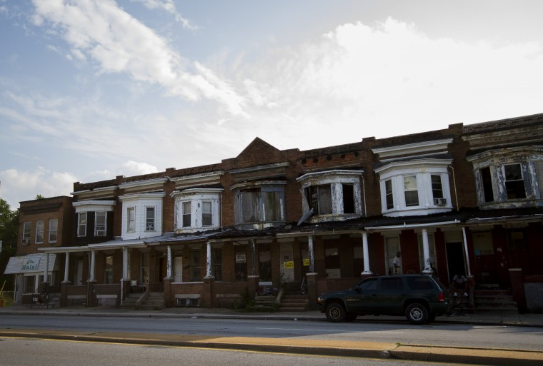As with many vacants in Park Heights, and around the city, one or two in between will be occupied while the others are boarded up and blocked off. (Kalani Gordon/The Baltimore Sun/August 2014)