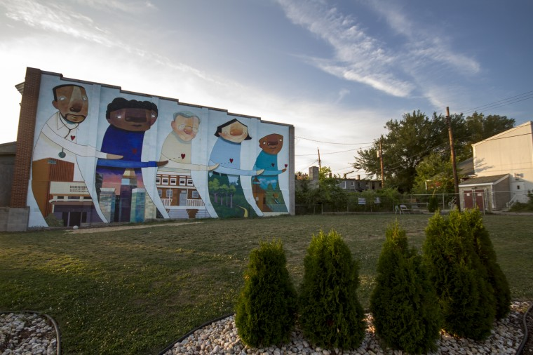 A vacant lot turned into a community garden through Park Heights Renaissance, across from St. Ambrose Outreach Center on Park Heights Avenue. (Kalani Gordon/Baltimore Sun/August 2014)