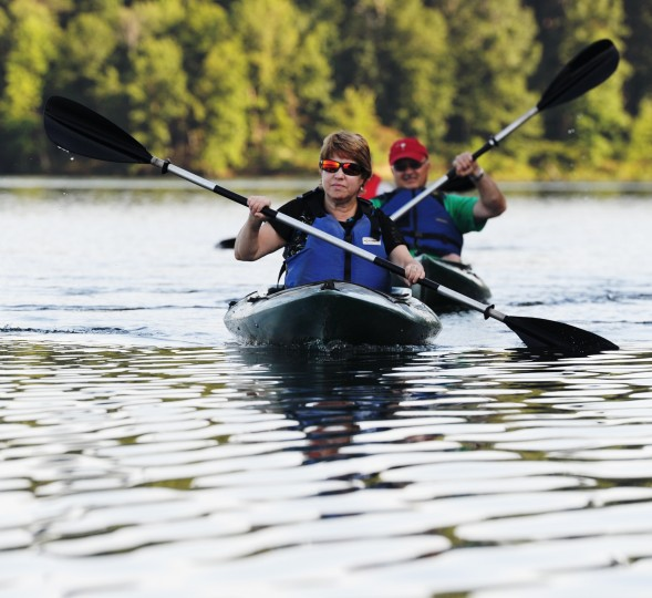 Jane Bench, front, of Sykesville, and Bill Matejka, rear, of Abingdon, kayak on a sunset nature tour of the Piney Run Reservoir on Saturday, Aug. 16, 2014. (Jon Sham/BSMG)