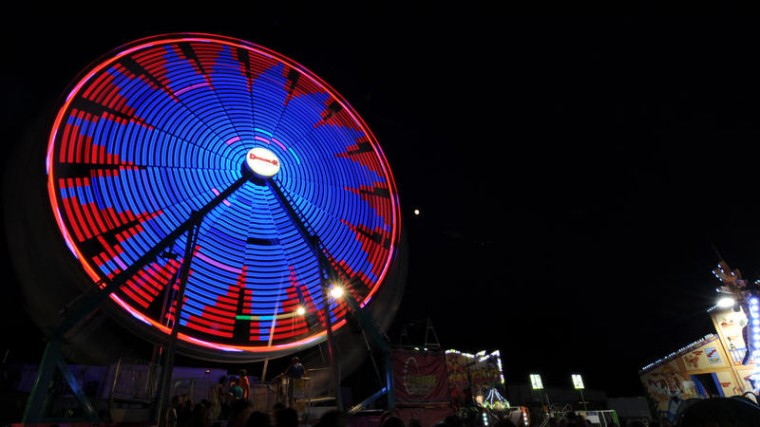 The Ferris wheel lights up as it spins at night at the Howard County Fair. (Jon Sham/BSMG)