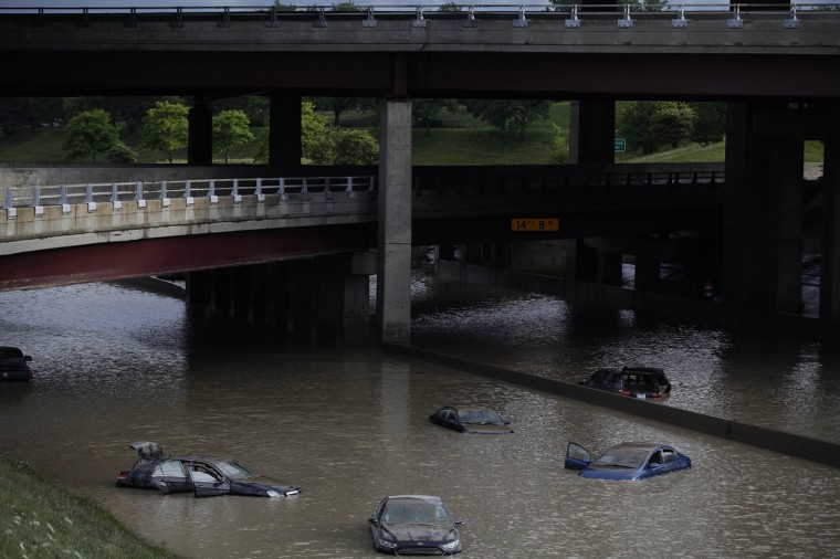 Vehicles sit submerged in water along I-75 August 12, 2014 in Royal Oak, Michigan. Severe rain from yesterday's storm flooded local streets, highways, and homes in the Detroit Metropolitan area experiencing the worst flash flooding in decades. (Photo by Joshua Lott/Getty Images)