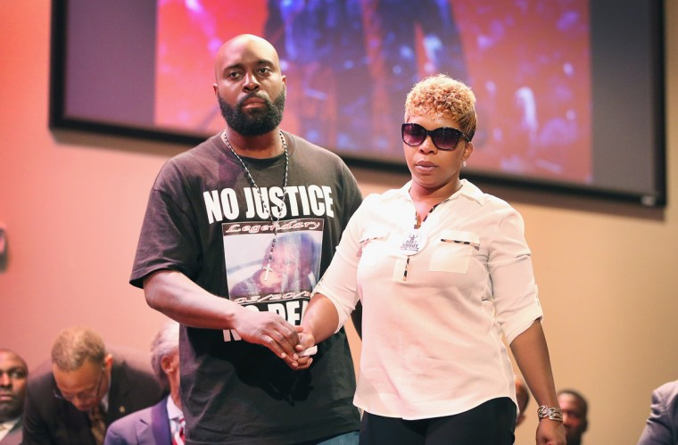 Michael Brown Sr. and Lesley McSpadden, the parents of slain teenager Michael Brown, attend a rally at Greater Grace Church on August 17, 2014 in Ferguson, Missouri. Their son was shot and killed by a Ferguson police officer on August 9. Despite the Brown family's continued call for peaceful demonstrations, violent protests have erupted nearly every night in Ferguson since his death. (Photo by Scott Olson/Getty Images)