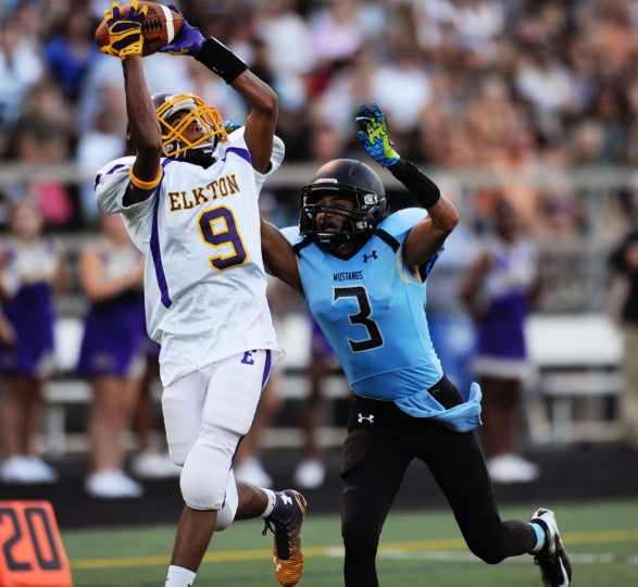 Elkton's Kyair Cook, left, catches the a pass just outside of the endzone while C. Milton Wright's Josh Bailey tries to defend during a football game at C. Milton Wright High in Bel Air, Friday, Sept. 5, 2014. (Jon Sham/BSMG)