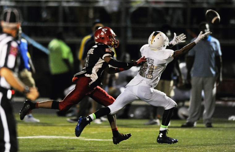 A long pass is just beyond the reach of Aberdeen's Isaiah Everett, right, as Edgewood's Ryan Webb closes in on him during the Maryland National Guard game of the week at Edgewood High School in Edgewood, Friday, Sept. 5, 2014. (Jon Sham/BSMG)