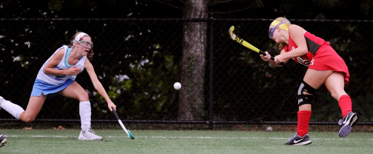 Elizabeth Seton's Meaghan Ryan, right, launches the ball past Mount de Sales' Caroline Batemen during a field hockey game at Mount de Sales Academy in Catonsville, Thursday, Sept. 25, 2014. (Jon Sham/BSMG)