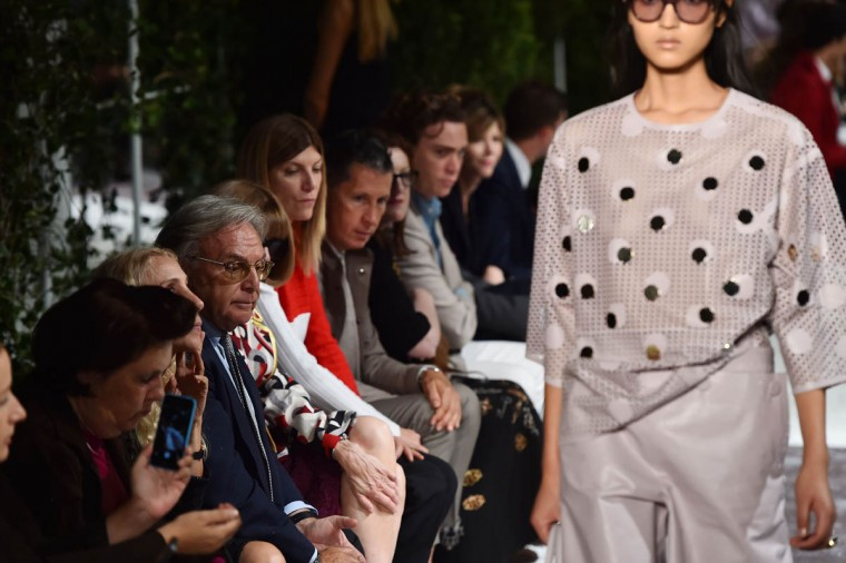 Diego Della Valle (3rd from Left), chief executive of luxury shoe company Tod's looks at a model presenting a creation from the Tod's collection during the 2015 Spring / Summer Milan Fashion Week on September 19, 2014 in Milan. (Gabriel Bouys/Getty Images)