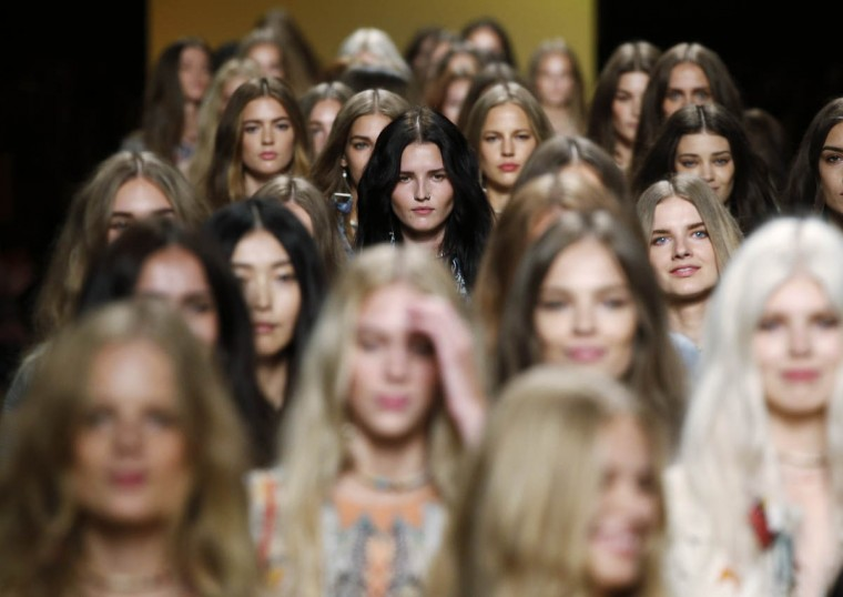 Models present creations from the Etro Spring/Summer 2015 collection during Milan Fashion week September 19, 2014. (Alessandro Garofalo/Reuters photo)