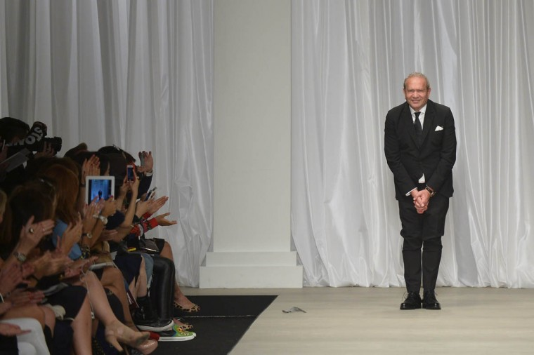 Designer Ermanno Scervino greets the audience at the end of his show during the 2015 Spring / Summer Milan Fashion Week on September 19, 2014 in Milan. (Tiziana Fabi/Getty Images)