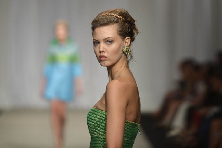 Model Lindsey Wixson presents a creation from the Ermanno Scervino collection during the 2015 Spring / Summer Milan Fashion Week on September 19, 2014 in Milan. (Gabriel Bouys, Tiziana Fabi/Getty Images)