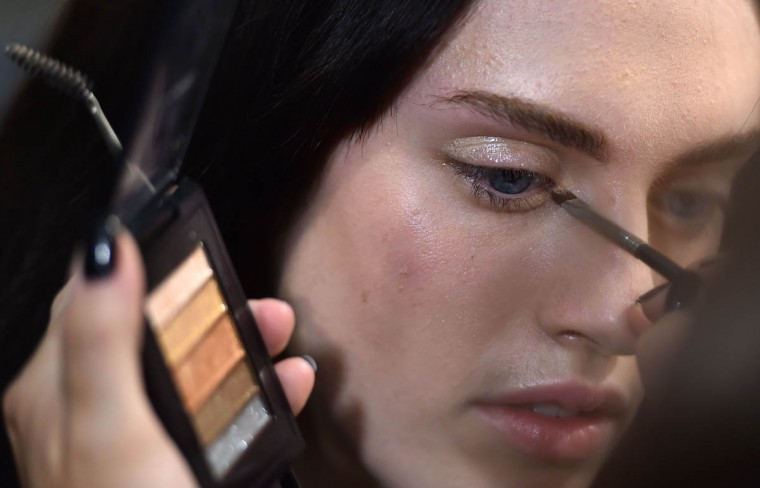 A model gets ready backstage before the Blumarine collection during the 2015 Spring / Summer Milan Fashion Week on September 19, 2014 in Milan. (Gabriel Bouys/Getty Images)
